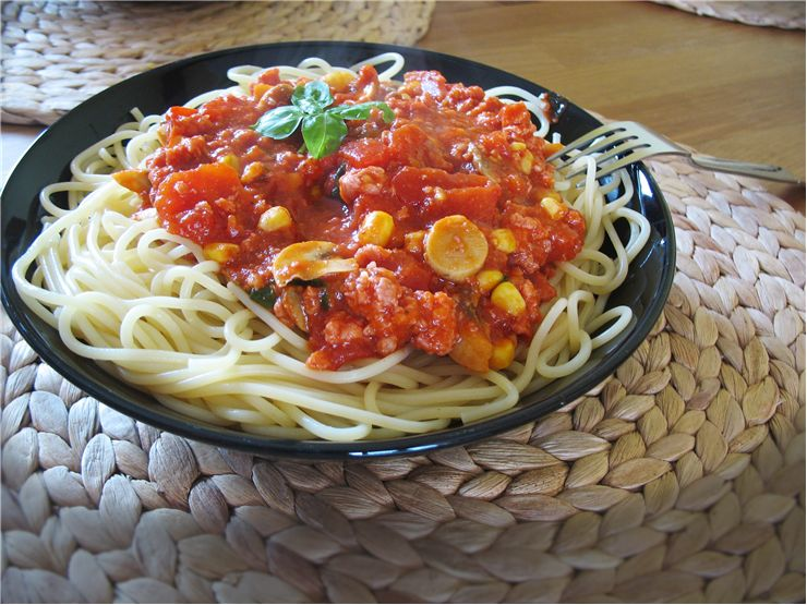 Spaghetti with Sauce at the Table